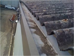 Asbestos Inspection - weathered roof and asbestos fibres in gutter